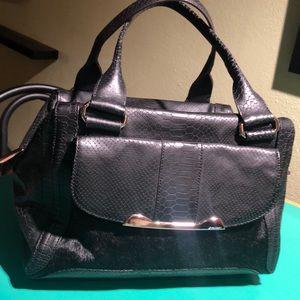 B. Makowsky Black Fur Expandable Shoulder Bag